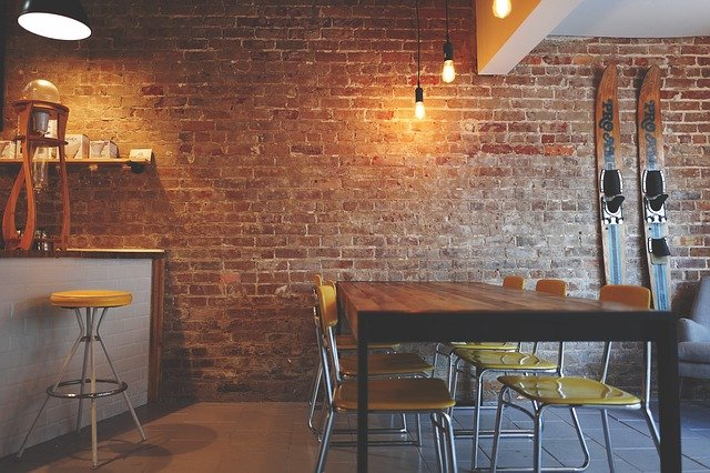 A dining room table in front of a brick wall